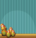 A blue wall with four russian dolls illustration of Royalty Free Stock Photo