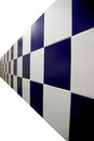 Blue walls are checkered pictuer the on white background Royalty Free Stock Image