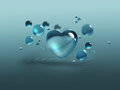 Blue water drops and heart Stock Image