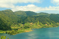 Blue water lake sete cidades azores sunny on lagoa azul one of the twin são miguel island mountain top view volcanic hills and Stock Images