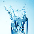 Blue water splash in glass Royalty Free Stock Photo