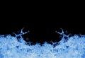 Blue water splashing on black Royalty Free Stock Photo