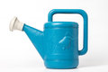 Blue watering can It is on a white background. Royalty Free Stock Photo