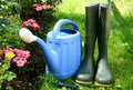 Blue watering and gumboots Stock Image