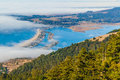 Blue waters green trees water and fog the relaxing view of the marin coastline stinson beach and bolinas lagoon with green trees Stock Photos