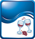 Blue wave backdrop with wine glasses and grapes Stock Photography