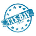 Blue weathered tax day april th stamp circle and stars a ink roughed up design with the word on it making a great concept Stock Photo