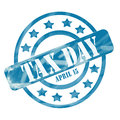 Blue weathered tax day april th stamp circles and stars a ink roughed up design with the word on it making a great concept Royalty Free Stock Photos