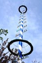 Blue and white bavarian maypole on blue sky horizontal Royalty Free Stock Image