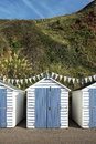 Blue and white beach huts at seaton devon uk a set of painted Royalty Free Stock Images