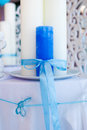 Blue and white candles tied with a ribbon on the table Stock Image