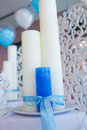 Blue and white candles tied with a ribbon on the table Royalty Free Stock Photography