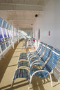 Blue and White Chairs  Enclosed Ships Deck Royalty Free Stock Photography