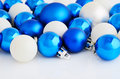 Blue and white christmas balls on the white background Royalty Free Stock Photo