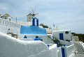 Blue white colouring on santorini island of building and windmill Stock Image