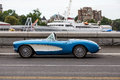 Blue and White Convertible by Harbor Royalty Free Stock Photo