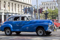 Blue and white cuban car havana cuba december driving past main square Royalty Free Stock Image