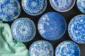 Blue and white decorative Japanese plates on black background -