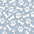 Blue and white dog paw prints and bones tile pattern repeat back background that is seamless repeats Stock Photos