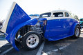 Blue and white hot rod with chrome engine Royalty Free Stock Photo