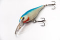 Blue and white lure for fishing with a three-arm hooks Royalty Free Stock Photo