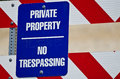 Blue and White Private Property Sign on Construction Barricade Royalty Free Stock Photo