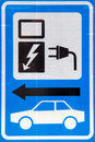 Blue white sign loading electric car Royalty Free Stock Photography