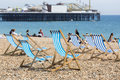 Blue and white striped deckchairs on Brighton beach Royalty Free Stock Photo