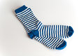Blue and white striped socks on white background two Stock Photo
