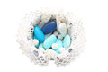 Blue and white sugared almonds in bowl covered with lace Royalty Free Stock Photo