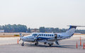 Blue and white turbo prop at airport a private airplane small Royalty Free Stock Image