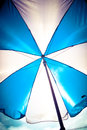 Blue and white umbrella nindoor bright sunny daybrilliant shade on a sunny day beautiful Stock Photo