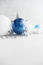 Blue and white xmas ornaments on glitter holiday background. Merry christmas card.