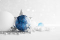 Blue and white xmas ornaments on glitter holiday background. Merry christmas card. Royalty Free Stock Photo