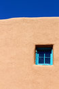 Blue window on adobe wall Royalty Free Stock Photo