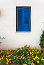 Blue window in greek style at old house Royalty Free Stock Photo
