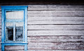 Blue  window on house with peeling paint Royalty Free Stock Photo