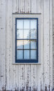 Blue window on an old white washed barn Royalty Free Stock Photo