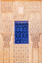 Blue window at a wall with Arabic ornaments Royalty Free Stock Photo