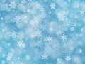 Blue winter boke background with snowflakes
