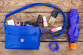 Blue womens purse things from open lady hand bag toned image Stock Image