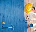 Blue wood floor with a brush, paint, tools and helmet Royalty Free Stock Photo