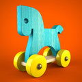 Blue wood horse toy on red background symbol of the new year d Royalty Free Stock Photo