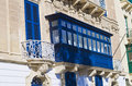 Blue wooden balcony an old in valletta city Stock Images