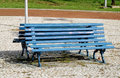 Blue wooden bench in the park Royalty Free Stock Photo