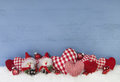 Blue wooden christmas background with brownie and red checked he Royalty Free Stock Photo