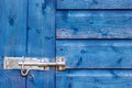 Blue wooden door background with lock Royalty Free Stock Photo