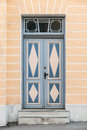 Blue wooden door with decor in old building facade tallinn estonia Stock Photos