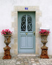 Blue wooden door with flower plants Royalty Free Stock Photography