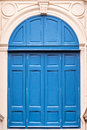 Blue wooden door in the folding style.